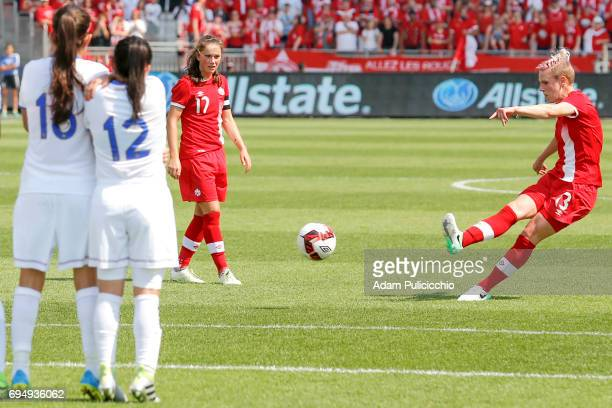 Midfielder Sophie Schmidt of Team Canada kicks the ball during a free kick as Team Costa Rica set up a wall to attempt to block the shot in a...