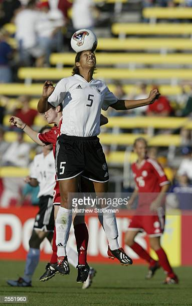 Midfielder Steffi Jones of Germany heads the ball against Canada during the FIFA Women's World Cup at Crew Stadium on September 20 2003 in Columbus...