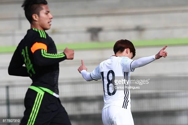 Midfielder Takumi Minamino of Japan celebrates scoring Japan's second goal during the match between Japan v Mexico U23 Friendly International at...