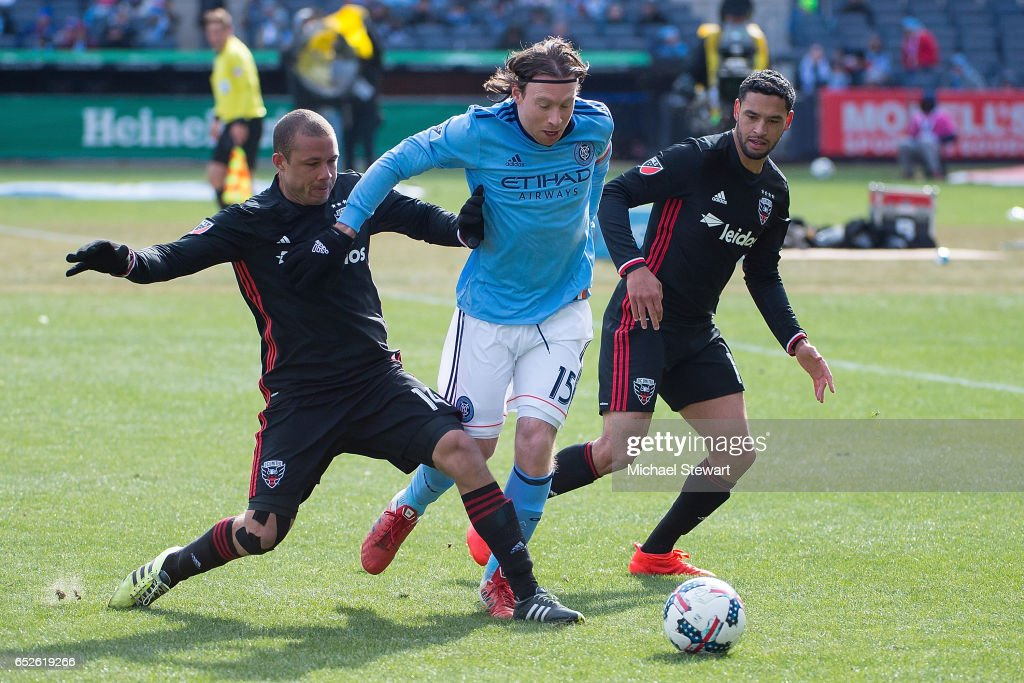Midfielder Thomas McNamara #15 of New York City FC, midfielder Nick DeLeon #14 of D.C. United and midfielder Lamar Neagle #13 of D.C. United vie for the ball during the match at Yankee Stadium on March 12, 2017 in the bronx borough of New York City. New York City FC deafeats D.C. United 4-0.