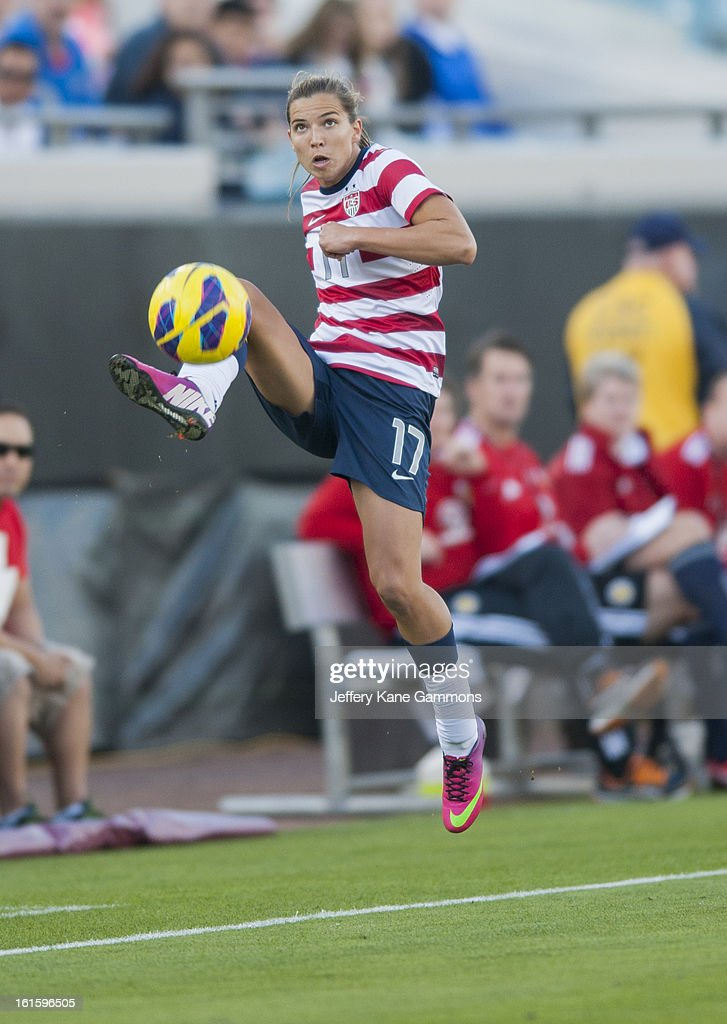 Midfielder Tobin Heath #17 of the United States keeps the ball from going out during the game against Scotland at EverBank Field on February 9, 2013 in Jacksonville, Florida.