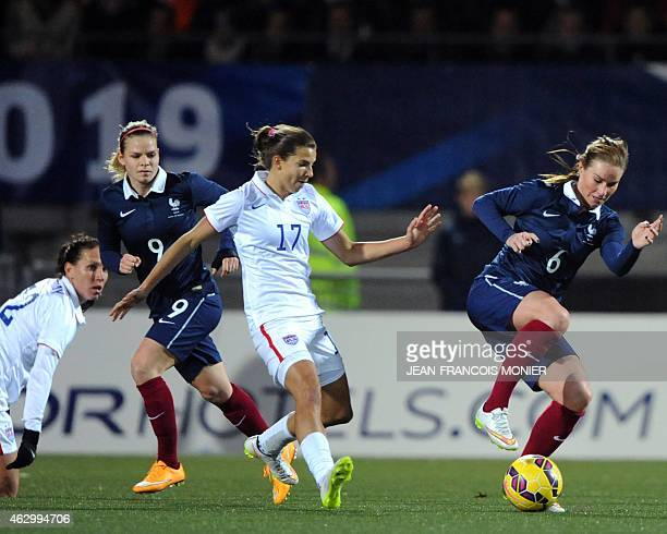 US' midfielder Tobin Heath vies for the ball with France's midfielder Amandine Henry during the Women's friendly football match France vs USA on...