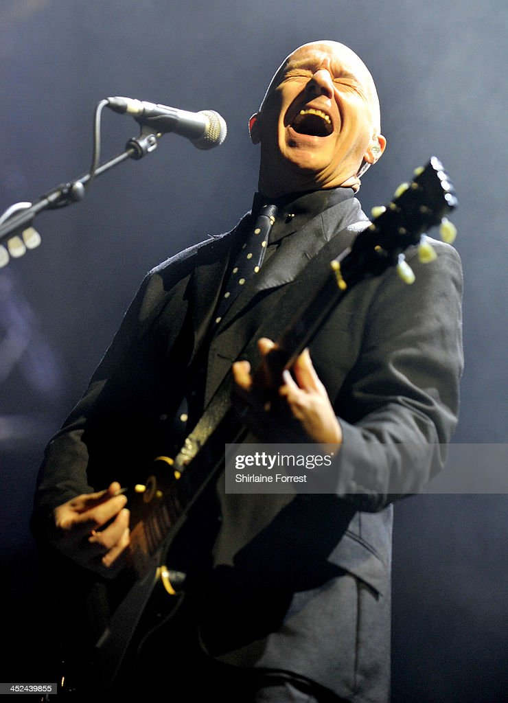 Midge Ure of Ultravox performs supporting Simple Minds at Phones4u Arena on November 28 2013 in Manchester England
