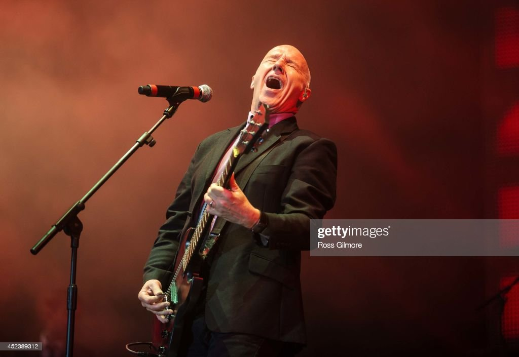 Midge Ure performs on stage at Rewind Festival Scotland at Scone Palace on July 19 2014 in Perth United Kingdom