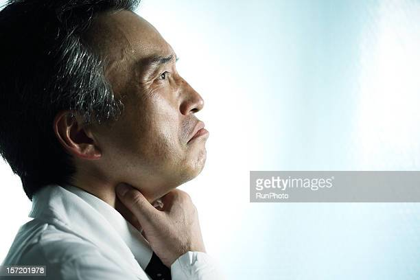 midle age doctor touching throat