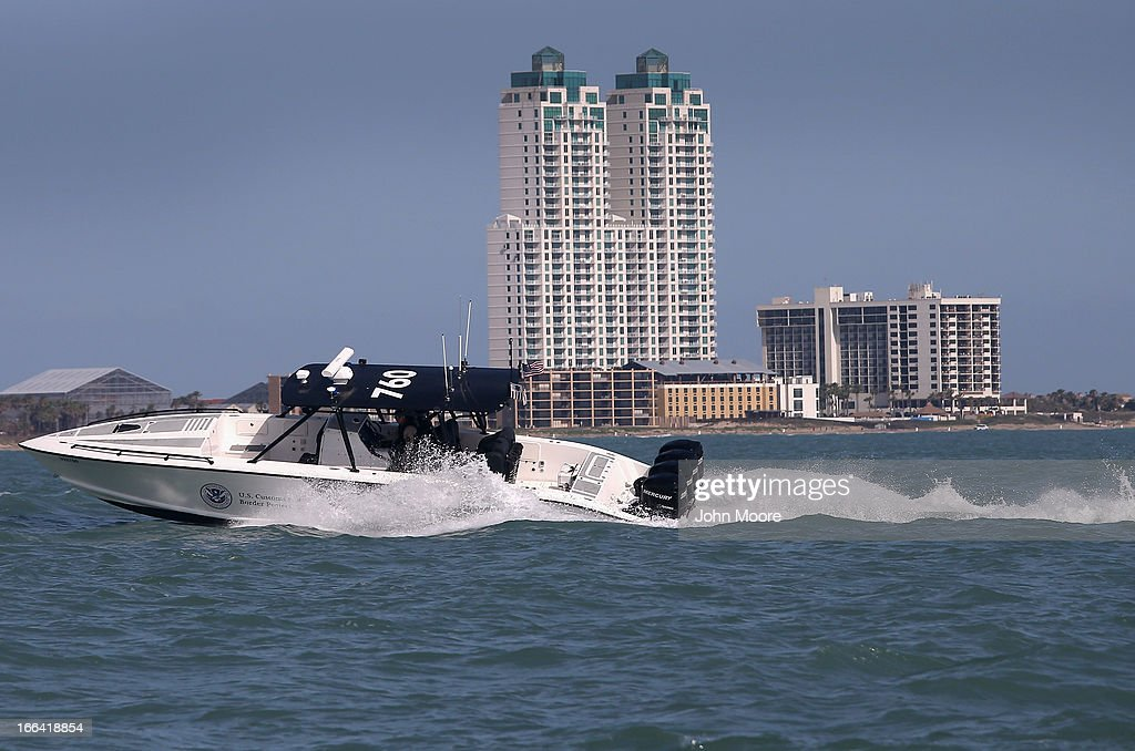 A Midnight Express interceptor from the U.S. Office of Air and Marine (OAM) races through the Gulf of Mexico on April 12, 2013 near Port Isabel, Texas. The crew patrols coastline waters near the U.S.-Mexico border searching for drug smugglers as well as illegal immigrants, which come across from Mexico near the mouth of the Rio Grande River. Their boat, a Midnight Express interceptor, is a 39 foot 900 horsepower craft capable of chasing smugglers down at 55 knots (63 mph). OAM units also push back illegal fishing boats out of U.S. waters.