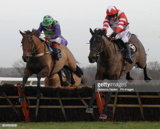Midnight Sail ridden by Robert Thornton jumps the last followed by Fistral Beach ridden by Ruby Walsh and goes onto win the Wessex Youth Trust...