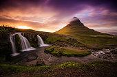 Sunset in Kirkjufell and Kirkjufellfoss, the Icelandic iconic mountain.