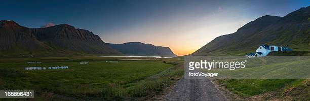 Midnight sun Arctic Circle fjord farms panorama Iceland
