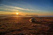 Midnight sun over campsite in Norway