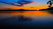 A summer picture with midnight sun on a lake