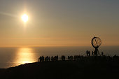 group of people observing Midnight Sun on Nordkapp, Norway