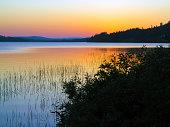 Midnight sun over a lake