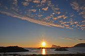 Midnight sun seen from Sommarøy in county Troms. Summer in Northern Norway
