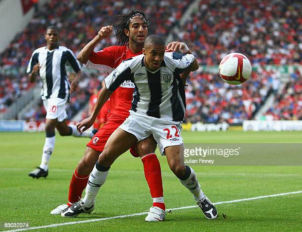 Mido of Middlesbrough battles with Gianni Zuiverloon of West Brom during the Barclays Premier League match between Middlesbrough and West Bromwich...