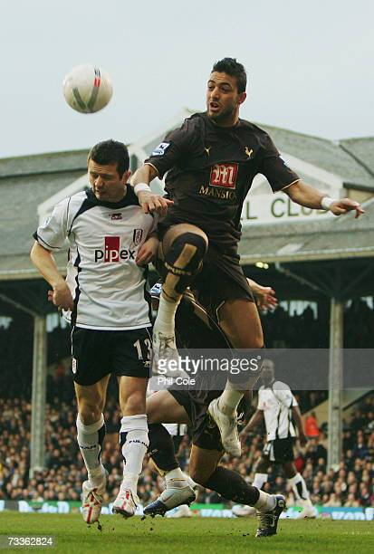 Mido of Tottenham Hotspur challenges Tomasz Radzinski of Fulham during the FA Cup sponsored by EON 5th Round match between Fulham and Tottenham...