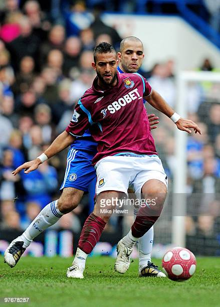 Mido of West Ham controls the ball as Alex of Chelsea closes in during the Barclays Premier League match between Chelsea and West Ham United at...
