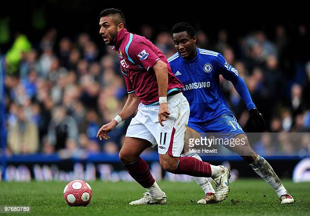Mido of West Ham is pursued by John Obi Mikel of Chelsea during the Barclays Premier League match between Chelsea and West Ham United at Stamford...