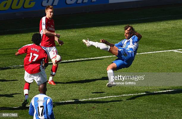 Mido of Wigan scores the opening goal during the Barclays Premier League match between Wigan Athletic and Arsenal at The JJB Stadium on April 11 2009...