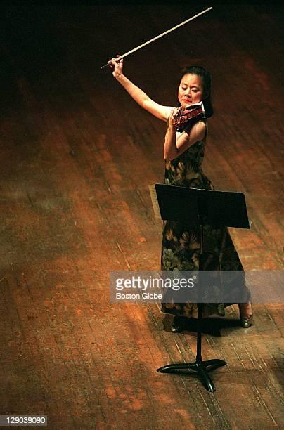 Midori a violinist performs at Boston Symphony Hall