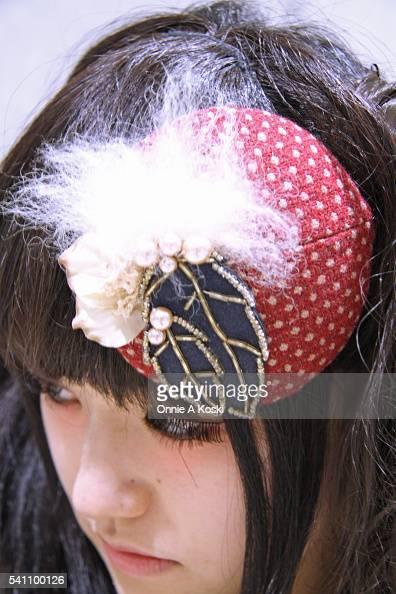 Midori Aida wearing a Pays Des Fees newsprint dress Jeffery Campbell skate bootie white platform wedge shoes a polkadot burgundy fascinator acorn...