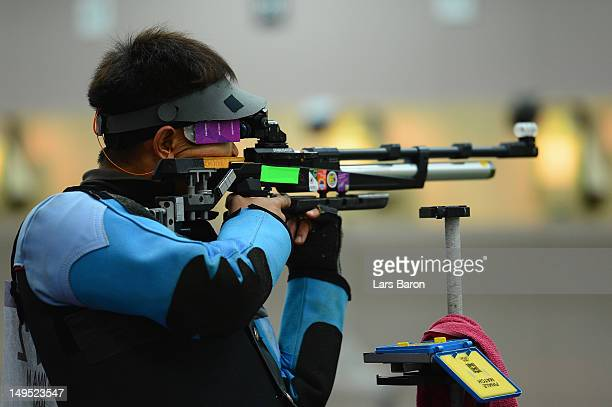 Midori Yajima of Japan competes in the Men's 10m Air Rifle qualification on Day 3 of the London 2012 Olympic Games at The Royal Artillery Barracks on...