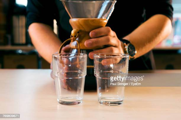 Midsection Of Barista With Coffee At Cafe