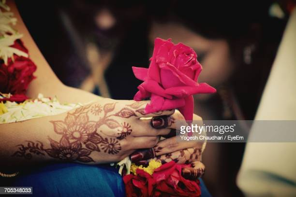 Midsection Of Bride Holding Rose