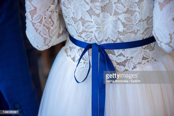 Midsection Of Bride With Blue Tied Bow On Waist
