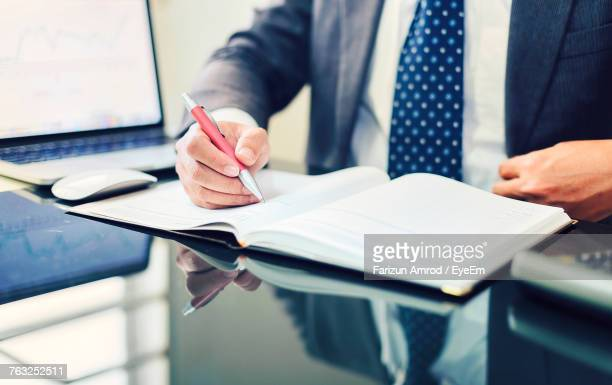 Midsection Of Businessman Working In Office