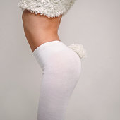 Midsection of Caucasian girl wearing rabbit costume