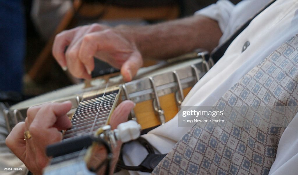 Midsection Of Man Playing Banjo