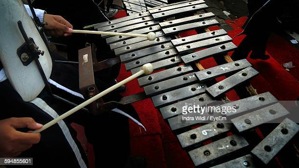 Midsection Of Man Playing Xylophone