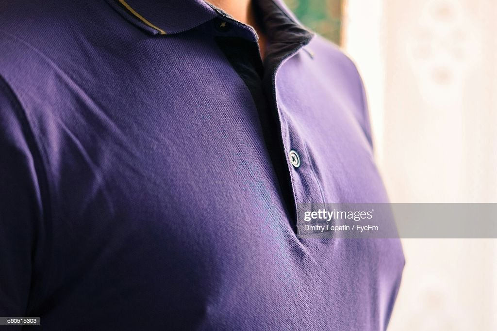 Midsection Of Man Wearing Purple T-Shirt