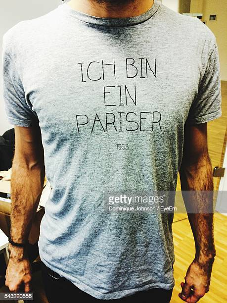 Midsection Of Man Wearing T-Shirt With Text On It