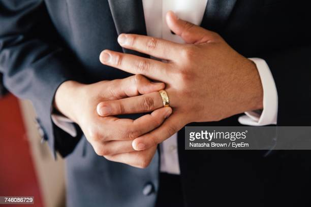 Midsection Of Man Wearing Wedding Ring