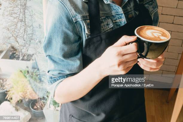 Midsection Of Man With Coffee At Cafe