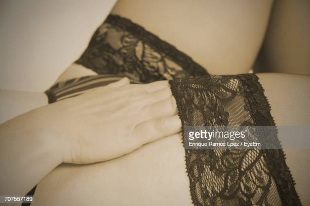 Midsection Of Sensual Woman In Lingerie