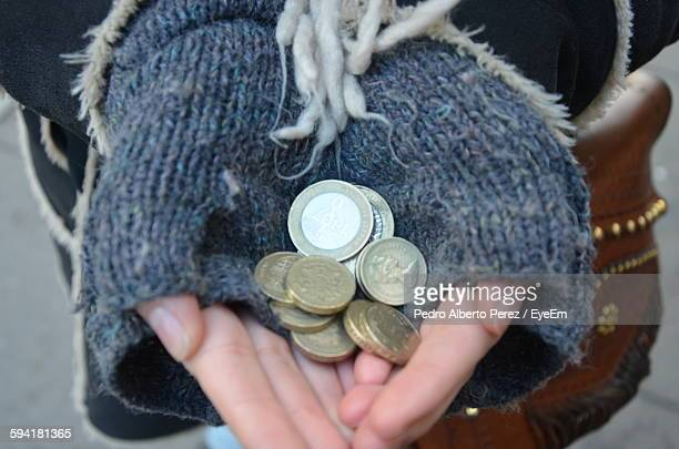 Midsection Of Woman Holding Coins On Street