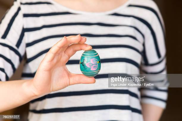 Midsection Of Woman Holding Easter Egg