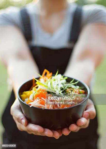 Midsection Of Woman Holding Poke Bowl