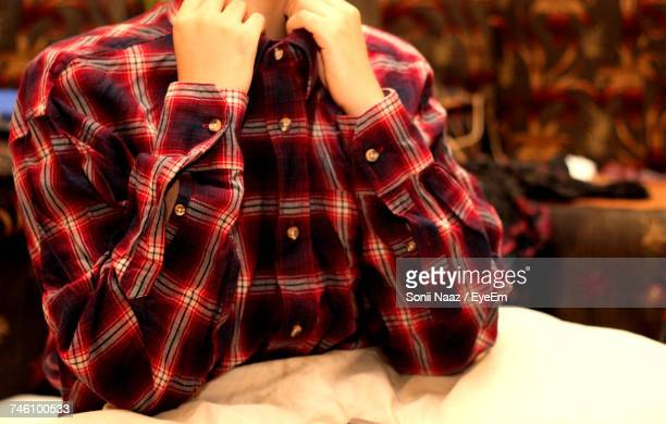 Midsection Of Woman Wearing Checked Pattern Shirt