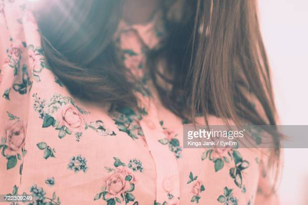 Midsection Of Woman Wearing Floral Shirt