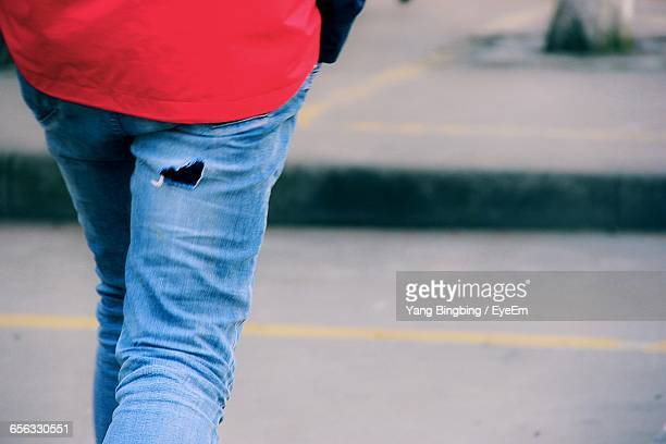 Midsection Of Woman Wearing Jeans With Hole