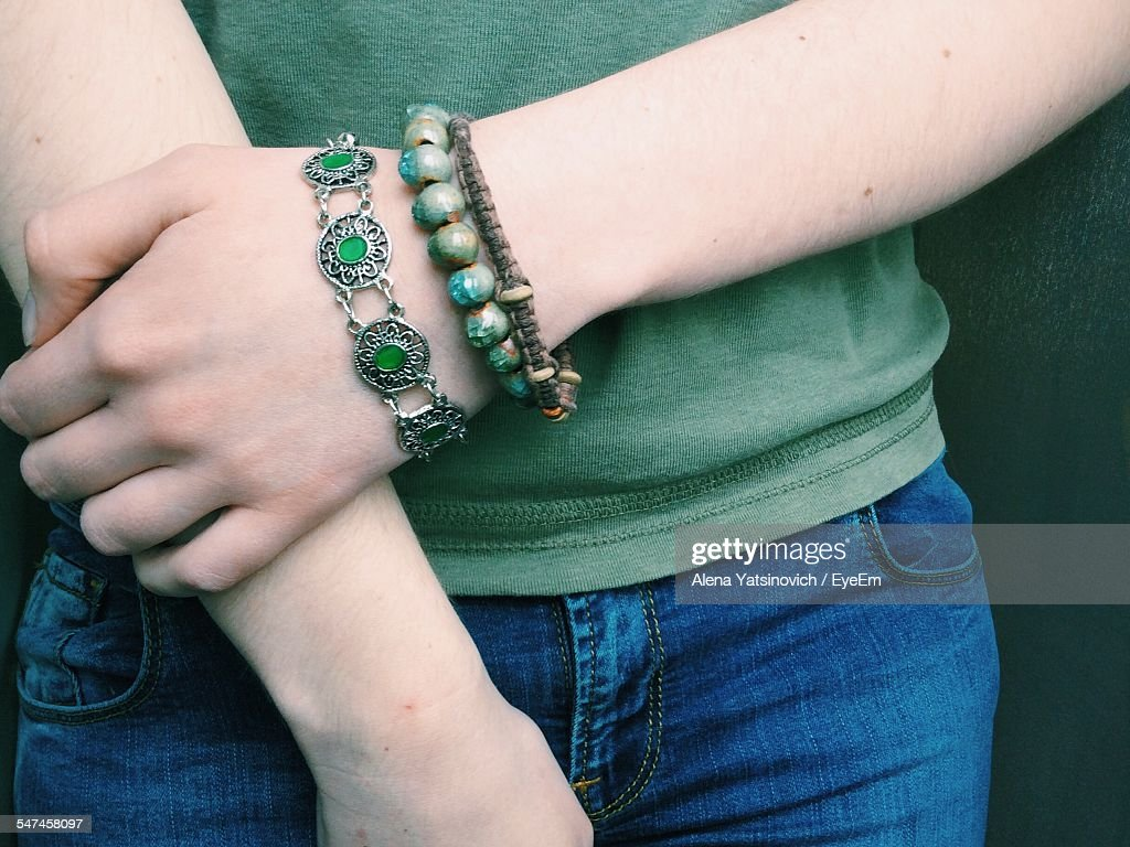 Midsection Of Woman With Green Bracelets