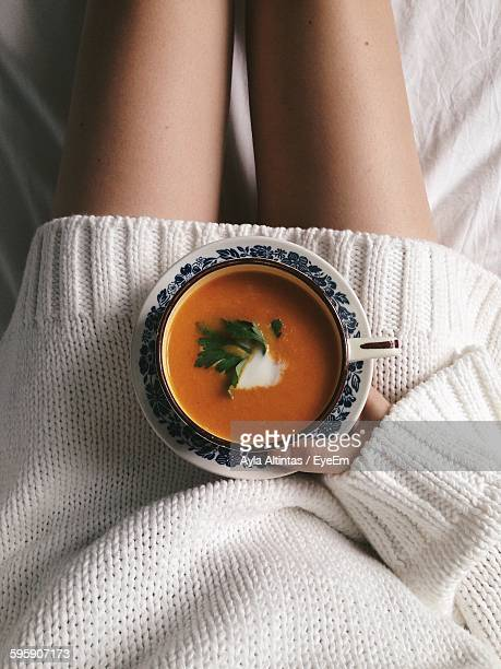 Midsection Of Woman With Soup At Home