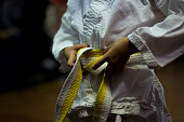 Midsection View Of Person Tying Karate Belt