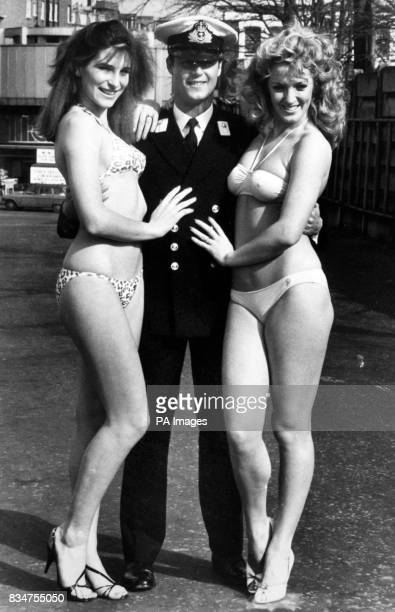 Midshipman Lee Stockdale getting to grips with model Caroline wearing a safari print bikini which sold for 1099 while Kim wears a yellow twopiece...