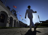 Midshipman Shawn Reed gets ready for graduation as he walks inside the Navy Marine Corps Memorial Stadium at the United States Naval Academy...