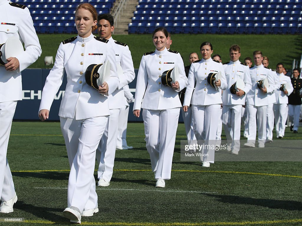 Midshipmen 1st Class walk to their seats during graduation ceremonies at the U.S. Naval Academy May 27, 2016 in Annapolis, Maryland. The is the first year that females are required to wear the same uniform as the males. U.S. Secretary of Defense Ashton Carter is this year's commencement speaker.